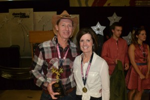 Rick and Julie DeVries pose with their trophy after winning the Star Fundraiser award during the Dancing with the Stars event