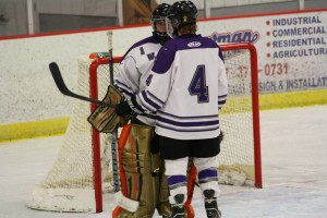 Spencer Johnson chats with Waldorf goalie.