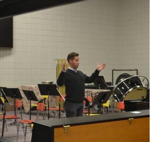 Waldorf's new choir and Schola Cantorum director, Brett Robison, conducting during rehearsal.