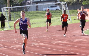 Chasen Selsor racing in the open 400 at the St. Louis track meet.