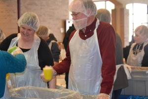 Cynthia Ryder and David Damm doing their part to help feed the hungry. Photo by Victoria Carra