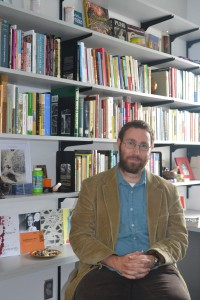 New Creative Writing professor Ryan Clark poses with his books - Photo by Jaci Olson