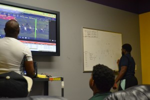Football team attending film study in addition to their regular academic and sports requirements. Photo by Kieren Wilson