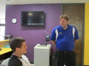 Jason Ramaker talks with Claudio da Cruz . Photo by Darien Walsh