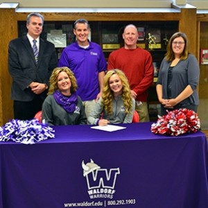Forest City's Payton Skjeie (front, right) recently signed with Waldorf.