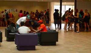 Students hanging out in a packed Atrium at Waldorf College. Photo by Kevin Moore