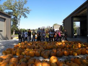Waldorf College volunteers together with the owner of Walking Eagle Pumpkin Patch. Photo by Erisha Menon
