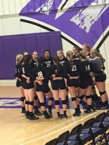 Waldorf circles up before a set to discuss game plan and focus for the next set on Tuesday vs. Clarke. Photo by Damon Helgevold